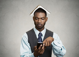 Serious businessman replying to e-mail on his smart phone