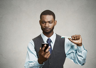 Busy life of executive. Man holding smart phone, toothbrush