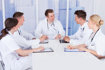 Doctors Having Conference Meeting In Hospital