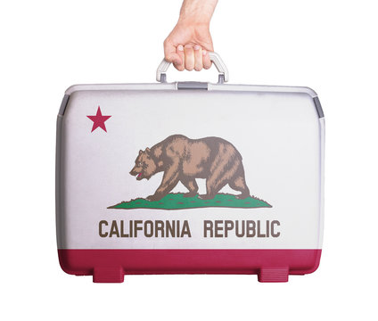 Used plastic suitcase with stains and scratches