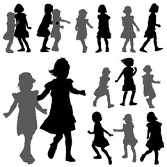 Silhouettes of small girls on the white background