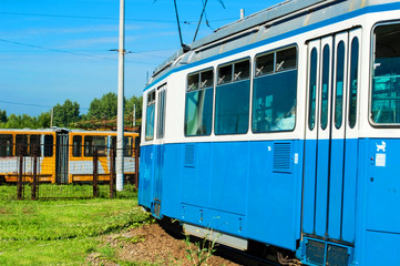 The city blue tram on turn