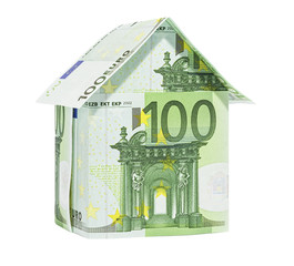 The house made of 100 Euro banknotes, isolated on white.