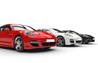 Three modern fast cars in a row, side angle view