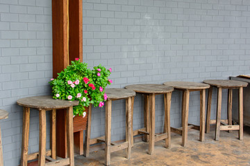 old vintage wooden table and wall with flower