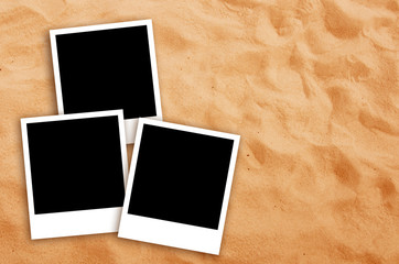 Three Blank photo frames on beach sand