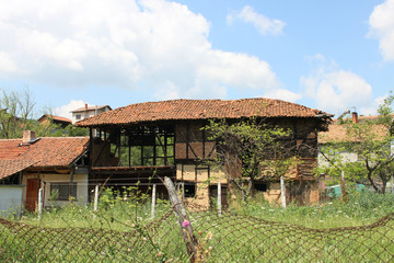 Rural scene with abandoned house in Bulgarian countryside