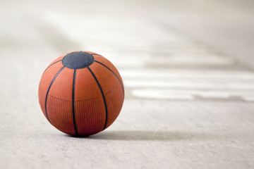 A basketball on the wooden floor as background