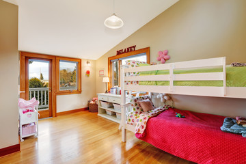 Bright kids room with loft bed