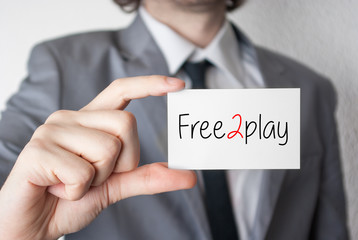 Free2play. Businessman showing business card
