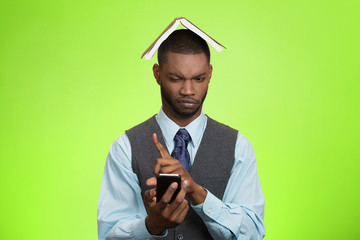 Man with phone book over head unhappy displeased face expression