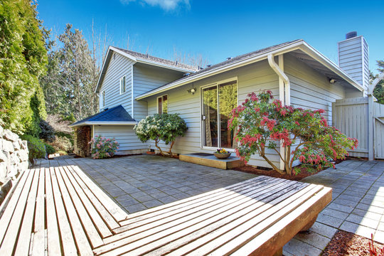 House backyard with wooden deck