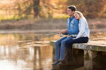 Printed kitchen splashbacks Fishing young couple fishing