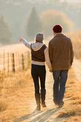 couple walking in country road