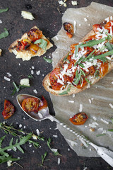 bruschetta with baked cherry tomatoes, parmesan and rocket