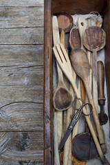 vintage old wooden cooking utensils group on wooden table