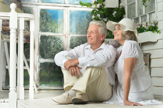 Elderly couple on wooden porch
