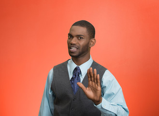 Portrait angry executive gesturing with hands to stop