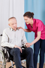 Nurse caring about disabled man