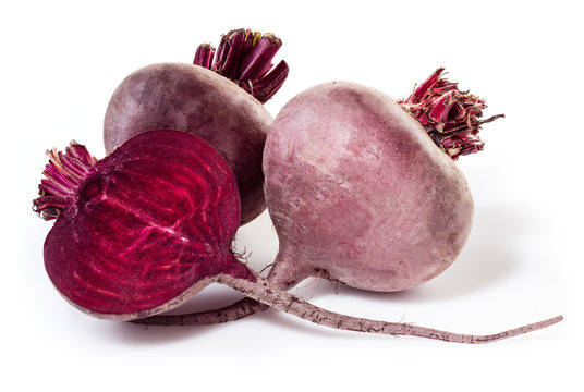 Fresh beetroot with half isolated on white