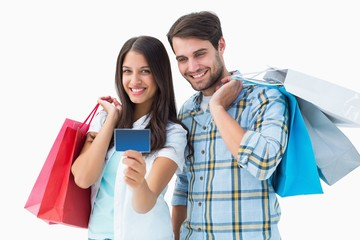 Attractive young couple with shopping bags and credit card