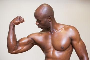 Shirtless muscular man flexing muscles
