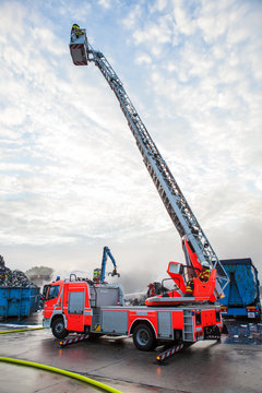 Fire truck with a cherry picker or elevated cage