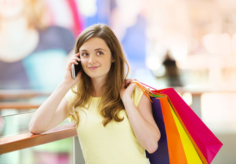Shopping girl with smartphone