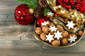 christmas decorations with cinnamon star cookies and walnuts
