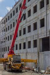 Construction site with concrete pump truck