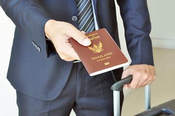 Businessman hand showing passport - airport security concept