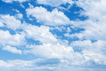 Bright blue cloudy sky background photo texture