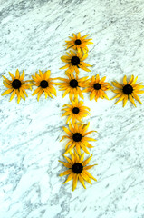 The cross of yellow flowers