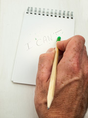 hand erases the letter T from the word can't