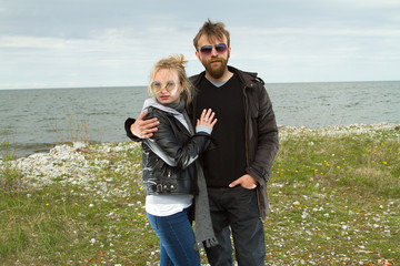 couple in love near the sea autumn