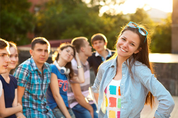 Female smiling student outdoors with friends