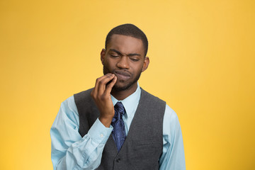 Man with tooth ache, pain isolated on yellow background