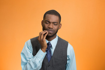 Man with tooth ache, pain, isolated on orange background