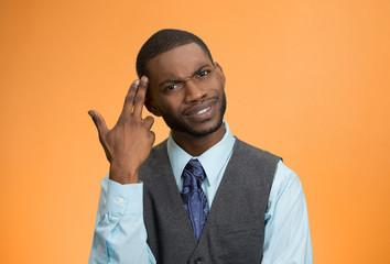 Man asking are you crazy, idiot? isolated on orange background