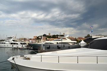 yachts on the sea and cloudy sky photo
