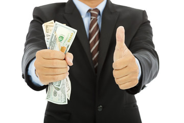 businessman clench us dollars and thumb up