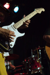 Man playing electric guitar on concert