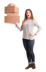 Surprised girl with a cardboard boxes