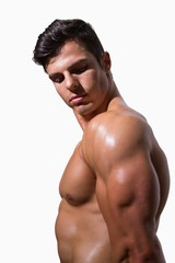 Side view of a shirtless muscular man