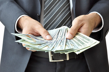 Businessman hand holding money -United States Dollars(USD) bills