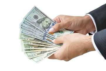 ็Hands holding money - United States Dollars (USD) banknotes