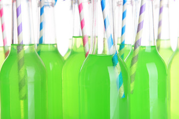 Bottles of drink with straw close up