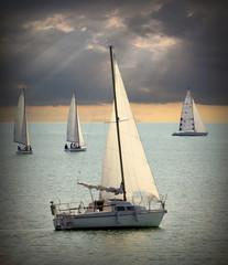 The Sailboats on a sea. Retro style picture.
