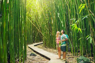 Photo sur Plexiglas Bamboo Couple hiking through bamboo forest