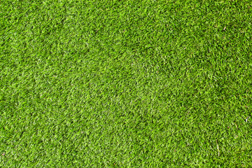 Green background of football field grass texture